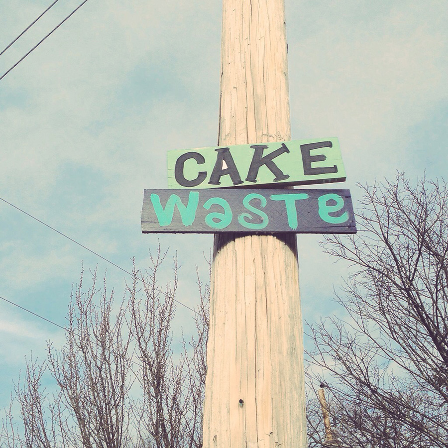 blackcattips street poems - streetfolk art - signs - cake waste
