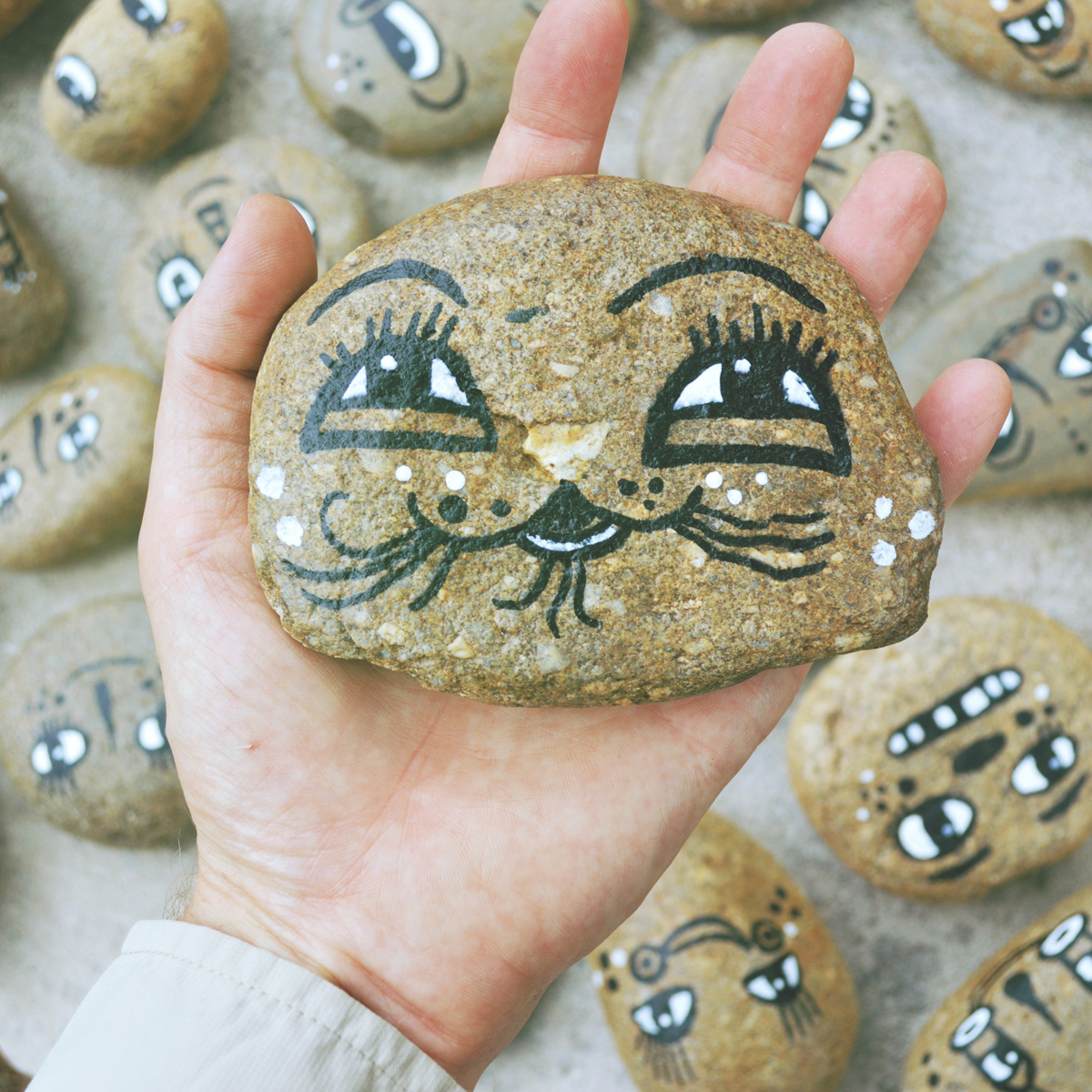 - BlackCatTips painted stones rocks faces.jpg -01